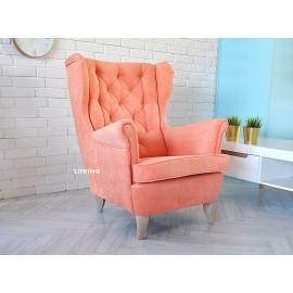 Fotel uszak w brzoskwiniowym kolorze